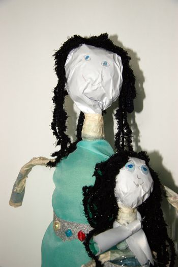 two dolls made from a plastic bottles