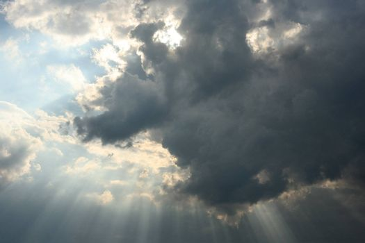 The image of a cloud with beams