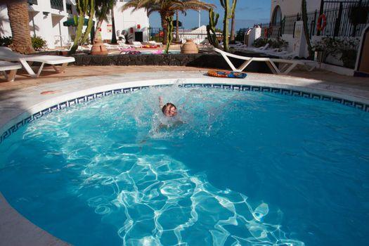 girl having fun in the pool