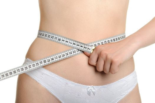 Female shapely a body and a measuring tape