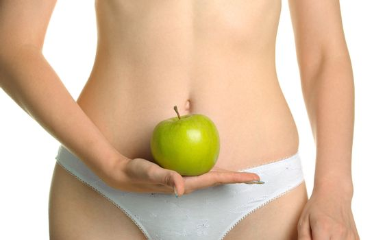 Female shapely a body and a green apple