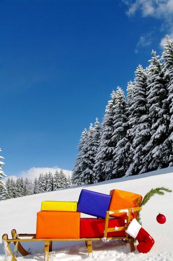 colorful presents on a Santa Claus sledge in a winter landscape