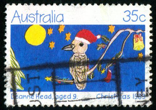 AUSTRALIA - CIRCA 1983: stamp printed by Australia, shows Kookaburra Bird Wearing Santa Hat, circa 1983