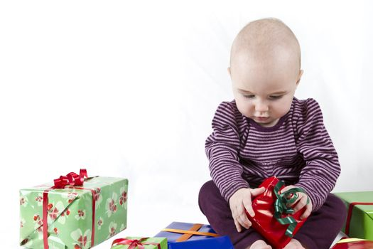 young child unpacking presents. white background