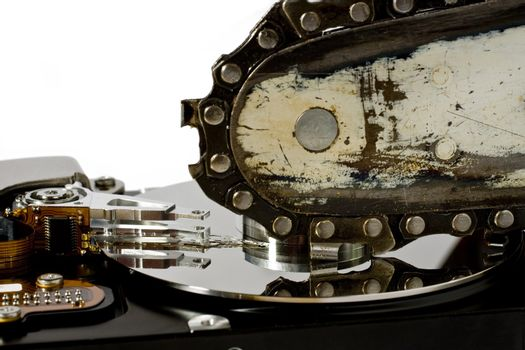 Chain saw over open hard disk drive. symbol for data loss