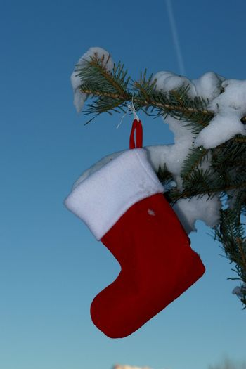 Santa Claus Christmas boot for gifts outside in a snowy landscape