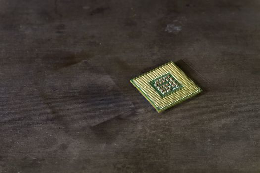 cpu laying on steel with pins up.