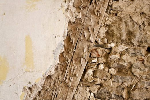 Old wall construction with wood, stone and render