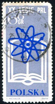 POLAND - CIRCA 1965: stamp printed by Poland, shows atomic symbol, circa 1965.