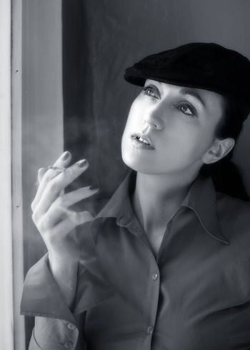 Woman with a cigarette in cap