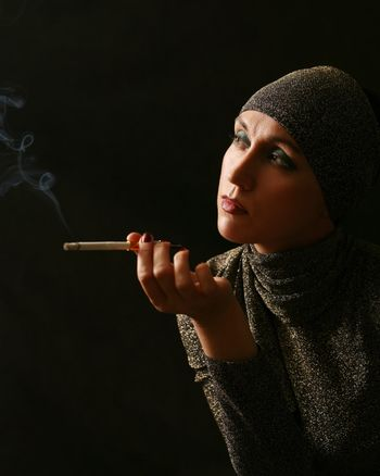Lady with a cigarette on black background