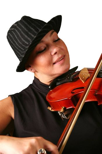 The woman in a hat playing its violin with a smile