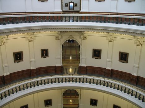 A view from across the rotunda of first, second and third floor entrances to the north wing of the Texas capitol building in Austin.