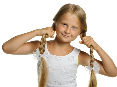 The pretty girl the blonde holding itself for braid