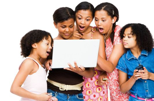 Shocked friends using a laptop isolated over white