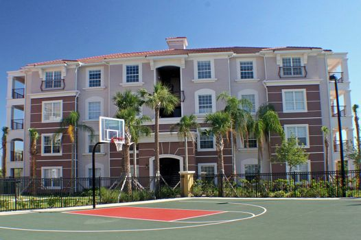 Colorful building behind basketball court in Florida.