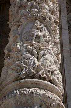 sculpture on column