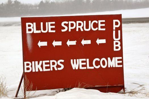Pub sign welcoming bikers