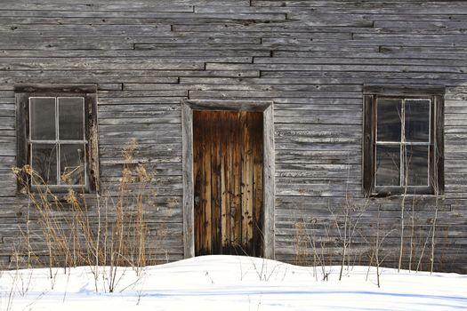 Snowdrifts against pioneer farm house