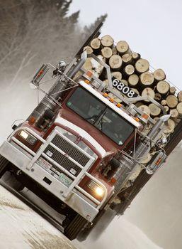 Logging truck on winter road