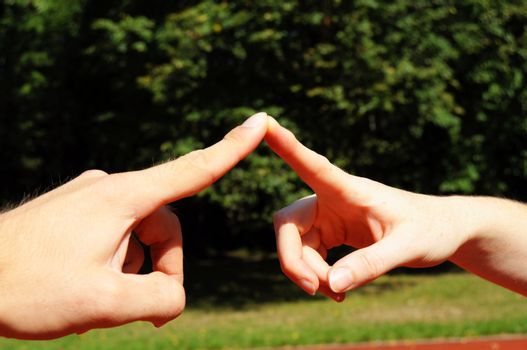 love concept with hands fingers and copyspace in nature