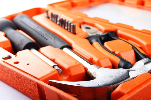toolbox kit with hammer and screwdriver showing construction concept