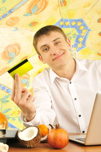 young businessman holding plastic card
