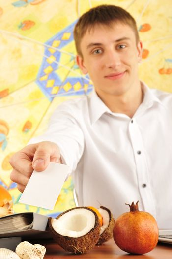 young man with a blank card