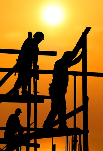 Construction workers under a hot blazing sun