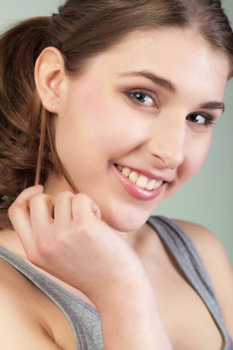 Closeup Portrait of smiling pretty teenager girl