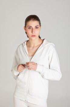 Portrait of teenager girl in white sportive dress