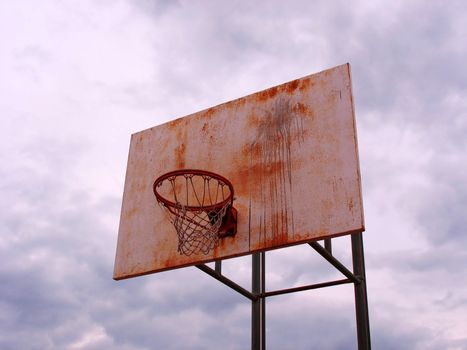 A shot of a playground basketball hoop and backboard.
