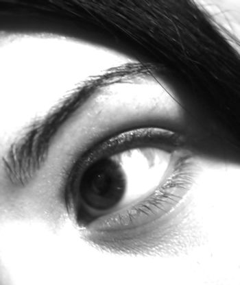 closeup of a girl's eye in black and white