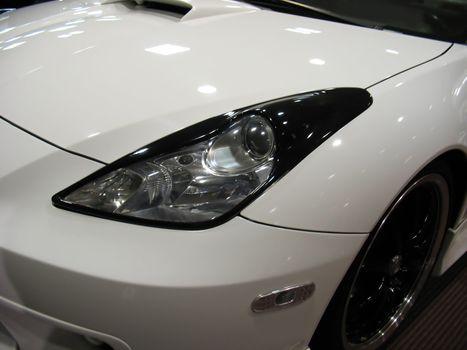 a detail shot of a sports car headlight