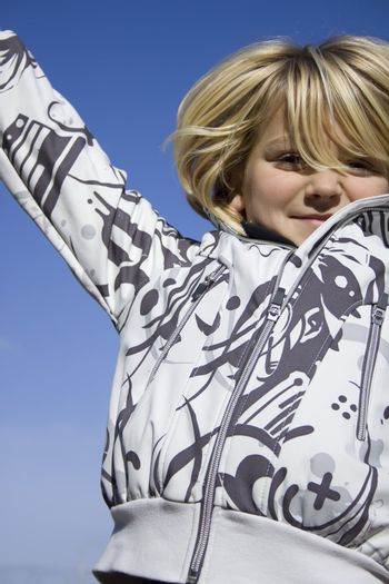 A girl jumping in front of the camera