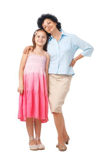 A full length portrait of grandmother embracing her grand daughter.