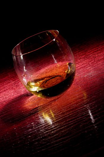 Whiskey on red glasstable