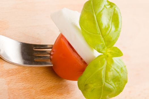 Fork with tomatoe and mozzarella