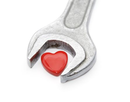 Wrench for heart. On a white background