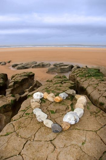 a love heart arranged with stones on the west coast of ireland near ballybunion