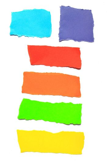 pieces of torn papers various color isolated on white background