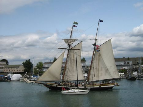 A photograph of a large wooden sail boat.