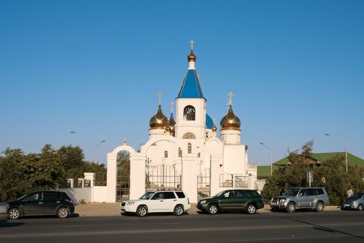 View of the Orthodox Church with the golden domes of the city of Aktau.