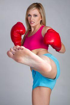 Beautiful athletic kick boxing woman