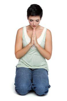 Isolated young spiritual woman praying