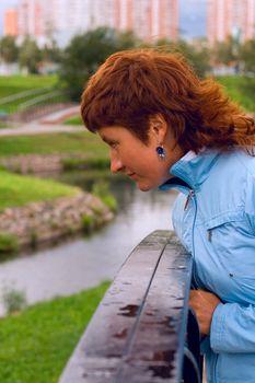 redhead woman on the bridge