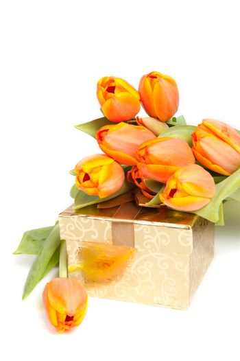 yellow orange tulips laying on a golden present