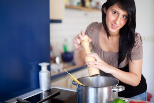 young woman cooking pasta