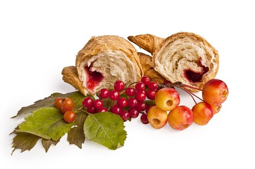 Croissant with berries and apples