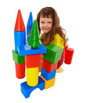 Child built a castle from color cubes